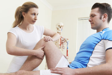 osteopath giving ultrasound treatment